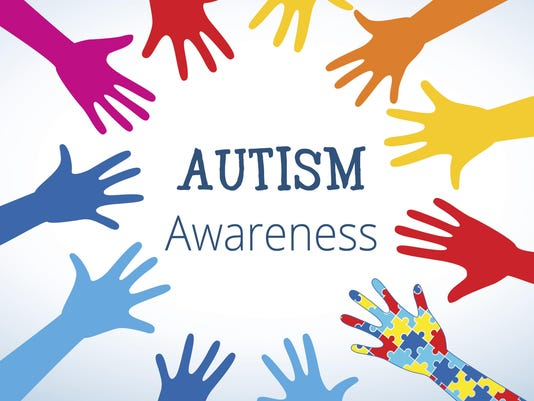 Autism awareness concept with hand of puzzle pieces
