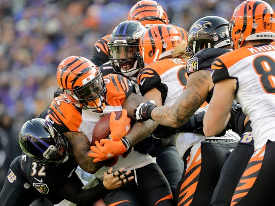 FILE - In this Sunday, Nov. 27, 2016, file photo, Cincinnati Bengals running back Jeremy Hill (32) is stopped by the Baltimore Ravens defense during the first half of an NFL football game in Baltimore.  All the Bengals running backs could manage was 50 yards combined in a loss to the Ravens. It's been one of many common threads in their out-of-sync offense. (AP Photo/Patrick Semansky, File)