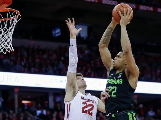 Miles Bridges shoots over Wisconsin's Ethan Happ during the first half Sunday.