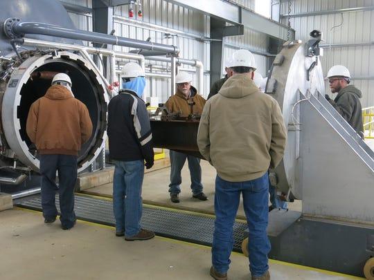 Letterkenny Munitions Center employees inspect the