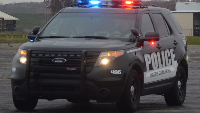 Battle Creek police said Saturday they arrested two men after finding a loaded gun in a vehicle.
