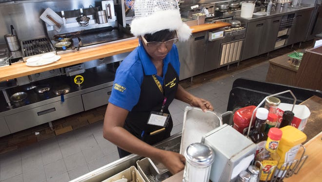 Schanta Blevins works Thursday, Dec. 21, 2017, at the Waffle House in Gulf Breeze. The popular diner is among the few restaurants that will be open Christmas.