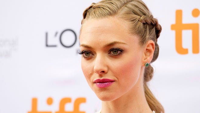 """Amanda Seyfried poses for photographs on the red carpet for the new movie """"While We're Young"""" during the 2014 Toronto International Film Festival in Toronto on Sept. 6, 2014. Seyfried, along with Melanie Griffith, Uzo Aduba, Peter Dinklage, Nina Dobrev and Pablo Schreiber will be appearing next month in the 14th annual benefit """"The 24 Hour Plays on Broadway,"""" which asks over a dozen actors, six writers and six directors to come up with six original short plays over the course of a day."""