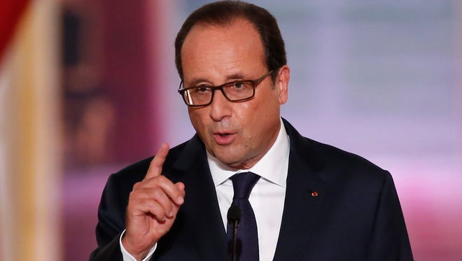 French President Francois Hollande speaks during his biannual press conference at the Elysee Palace in Paris on Sept. 18, 2014.