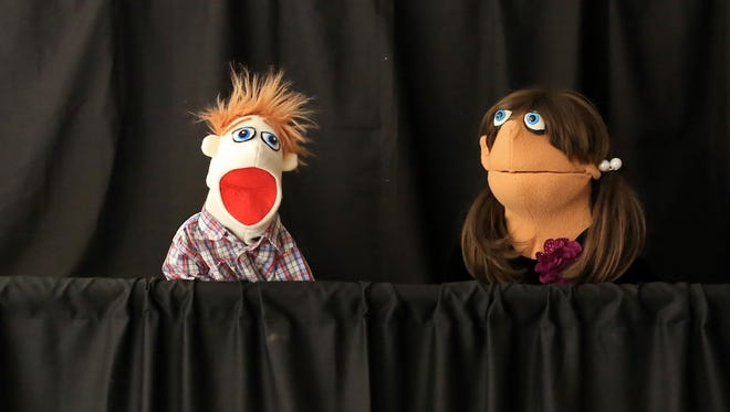 Two puppets put on a melodrama March 18 during A Day of Puppetry at the DiFiore Center in St. George.