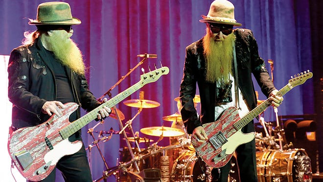 ZZ Top band members Dusty Hill, left, and Billy Gibbons hit the stage along with drummer Frank Beard at the sold-out Abraham Chavez Theatre in April 2015.