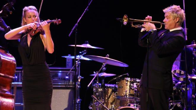 Violinist Caroline joined Chris Botti for several songs Thursday.