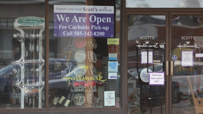 Phase 1 of the re-opening of certain businesses in Rochester and Finger Lakes region started Friday, May 15, 2020.  The process will be gradual to make sure the spread of COVID-19 stays down.  Scott's Hallmark in Irondequoit posted a large sign in their picture window letting customers know they are open for business.  They have been doing curbside pick up since May 4th.