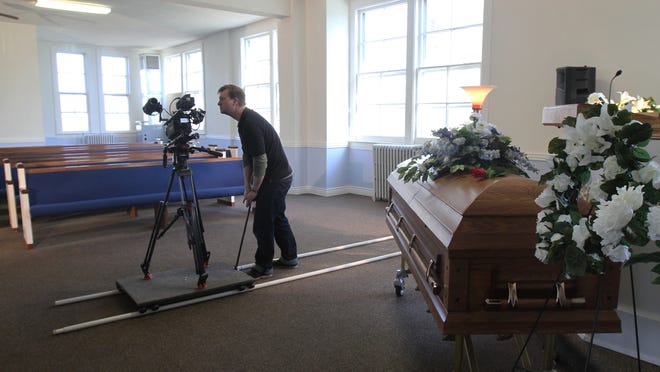 Joshua Bloodworth, with Rochester Community Television, films portions of D.M. Williams Funeral Home on April 24, 2014, for the violence prevention film The Front Row.