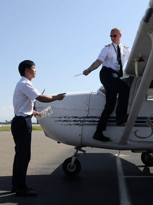 IASCO Flight Training student pilot Sheldon Wang, left, goes through pre-flight checks with Jeffrey Bisette. the school's stage check examiner, on Tuesday at Redding Municipal Airport.