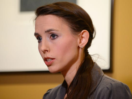 Former gymnast Rachael Denhollander addresses the media