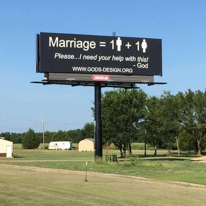 This photo shows a billboard designed by God's Original