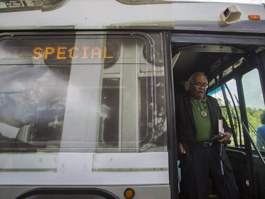 Attorney John Due steps of a Star Metro bus after taking a symbolic ride in honor of the 60th anniversary of the Tallahassee bus boycott on Thursday, May 26, 2016.