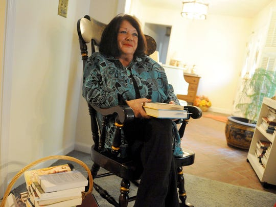 Judy Hatcher talks about some of her favorite books during an interview in her Staunton home on Thursday, Oct. 21, 2010.