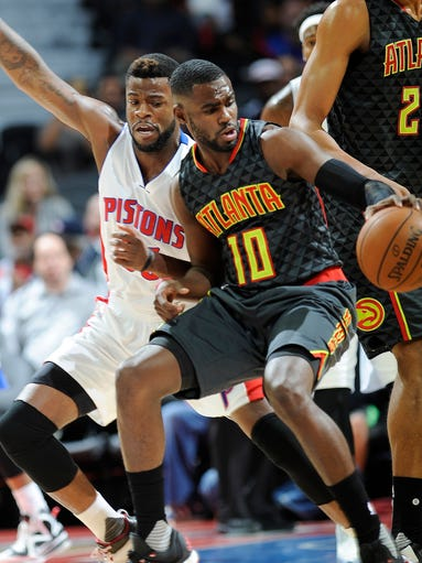 Pistons' Reggie Bullock defends the Hawks' Tim Hardaway