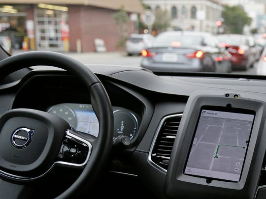FILE - In this Dec. 13, 2016 file photo, an Uber driverless