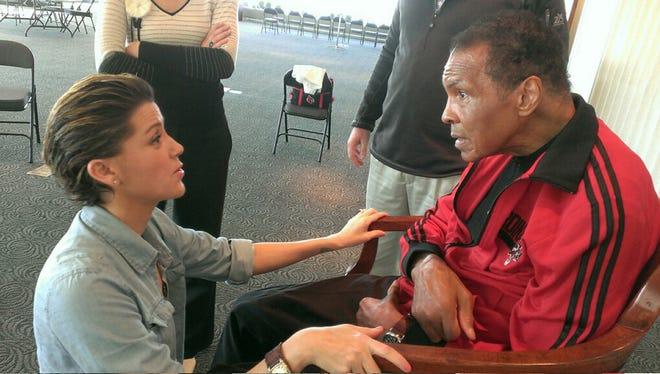 Jill Conley meets Muhammad Ali at the Ali Center, Wednesday.