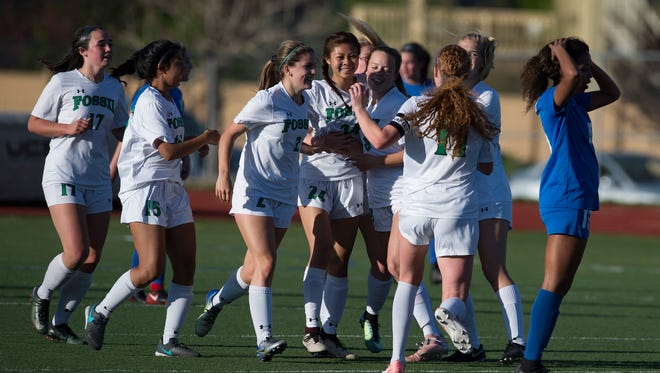 Fossil Ridge High School players celebrates a goal by Susan Hsin during a 4-0 win Tuesday night over Rampart in the first round of the Class 5A girls soccer playoffs. Visit Coloradoan.com for a photo gallery and roundup of girls soccer playoff games..