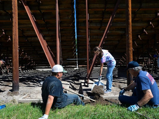 Volunteers make repairs to the Augusta Rodeo grounds,