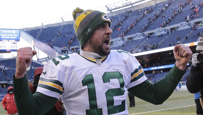 Green Bay Packers quarterback Aaron Rodgers pumps his fists after defeating the Chicago Bears on Dec. 18, 2016, at Soldier Field.