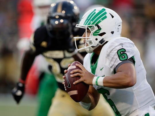 North Texas quarterback Mason Fine (6) looks for an open receiver to pass to against Southern Mississippi first the half of their NCAA college football game in Hattiesburg, Miss., Saturday, Sept. 30, 2017. (AP Photo/Rogelio V. Solis)