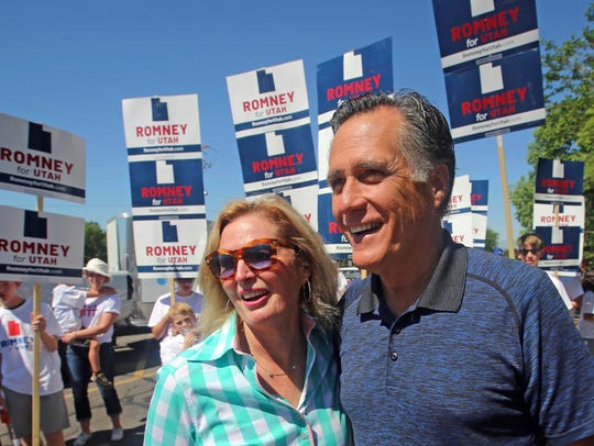 Mitt and Ann Romney walk in the Strawberry Day Parade