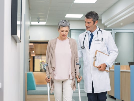 Doctor and patient with crutches