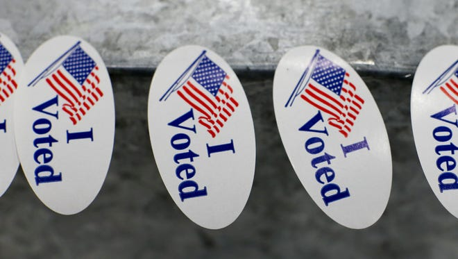 """""""I voted"""" stickers sit on a ballot box waiting to be picked by a voter in Tuesday's election at the Montana ExpoPark Exhibition Hall."""