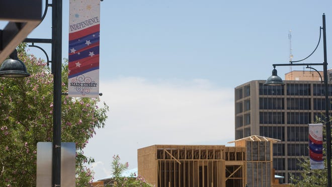 The city of Las Cruces prioritized a vibrant downtown in its five-year strategic plan, released Monday, July 17, 2017. Pictured Tuesday is construction of The Amador, a new gateway into downtown Las Cruces that will include shops, restaurants, bars and a plaza. The Wells Fargo Tower is in the background.