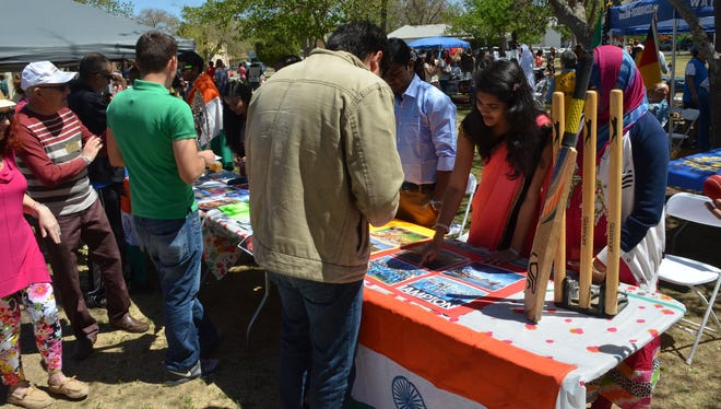 A group of students from India speak with attendees of the 2016 Las Cruces International Festival. Organizers said the festival is an opportunity for the Las Cruces international community to showcase their cultures and heritage.
