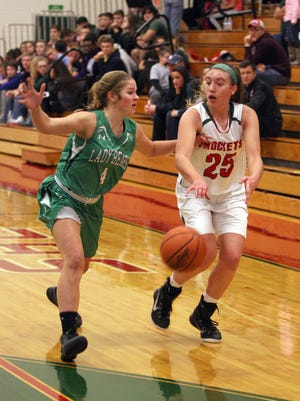 Ashley Riley dumps a pass down for Oak Harbor as Margaretta's Taylor Malson defends.