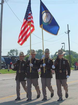 The Boone County Sheriff Color Guard carries flags at a Memorial Day parade in Florence.