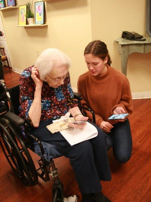 Ashley Settle assists a resident at Brookdale Senior Living in Westlake Hills during a technology help session in February. Settle, along with her friend and Westlake High classmate Lauren He, started an organization called Link for Seniors that brings technology assistance to the elderly.