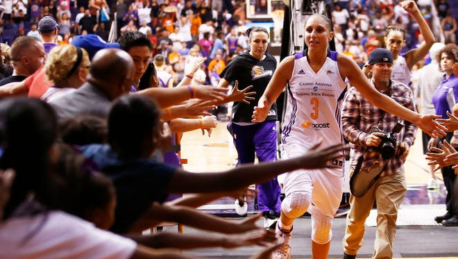 Diana Taurasi celebrates a playoff win with Mercury fans.