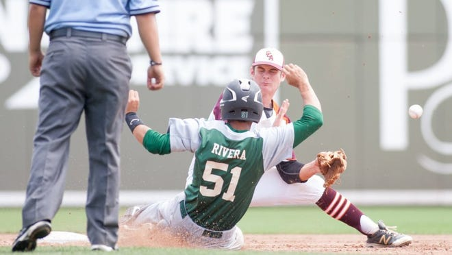 Josue Rivera (51) safely slides into second base as the ball gets past shortstop Aaron Anderson (9) during the Seacrest vs Jacksonville-Christ's Church Academy baseball game in the Class 2A state semifinals at JetBlue Park in Fort Myers, FL on Wednesday, May 11, 2016. Rivera went to third on the errand throw. (Photo by Gregg Pachkowski/Special to the Daily News)