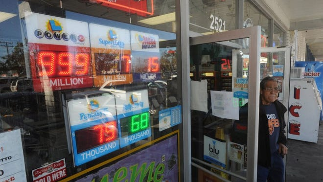 The powerball lottery prize reached a record of $1.5 billion in January 2016, but signs at Allan's Market Wine & Lotto could only go up to $999 million.