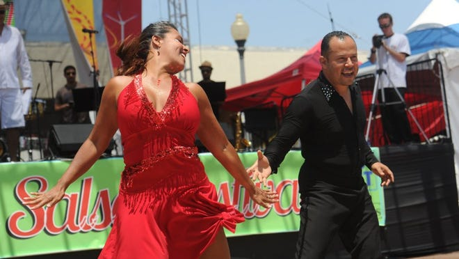 Seana-Marie Sesma dances with Lovie Hernandez during the dance contest at the Salsa Festival at Plaza Park in Oxnard in 2016.
