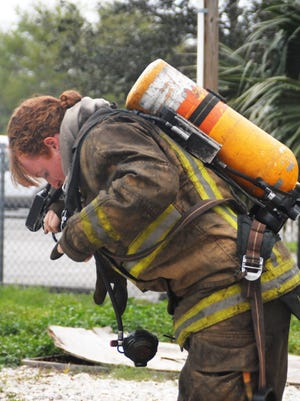 Firefighter/paramedic Larissa Conroy is shown training with the Brevard County Fire Rescue in this 2014 file photo.