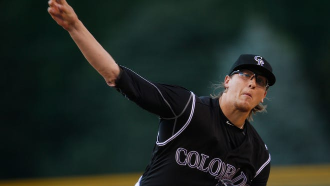Colorado Rockies starting pitcher Jeff Hoffman delivers a pitch to Chicago Cubs' Anthony Rizzo during the first inning of a baseball game Saturday, Aug. 20, 2016 in Denver. Hoffman was making his first appearance in the majors.