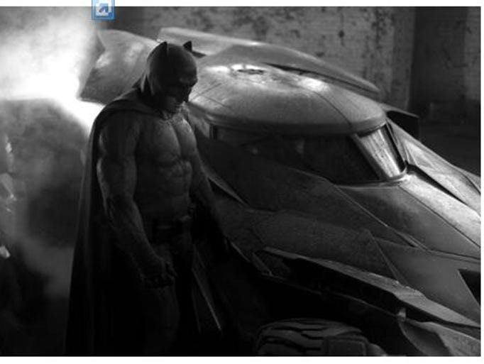 Batman broods next to the next Batmobile for Batman vs. Superman
