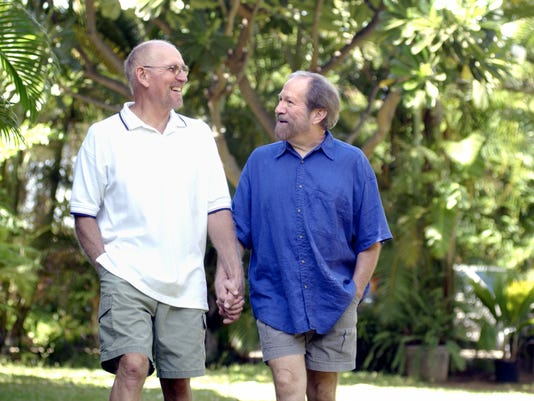 Male couple outdoors holding hands