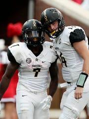Vanderbilt quarterback Kyle Shurmur (14) celebrates