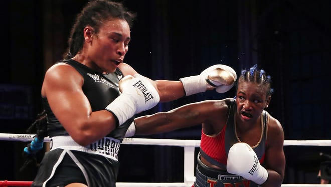 Claressa Shields, right, throws a punch at Hanna Gabriels during the 10th round of their IBF and WBA women's middleweight championship boxing bout in Detroit on Friday night.