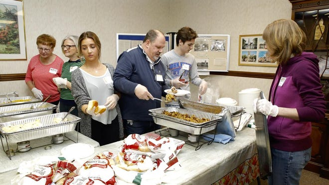 Volunteers at Court Street United Methodist Church in Rockford prepare plates of food on Nov. 23, 2017, for those attending a free traditional Thanksgiving meal at the church. Only carryout meals will be available on Nov. 26 as restrictions limit crowd size to prevent spread of the highly contagious coronavirus.