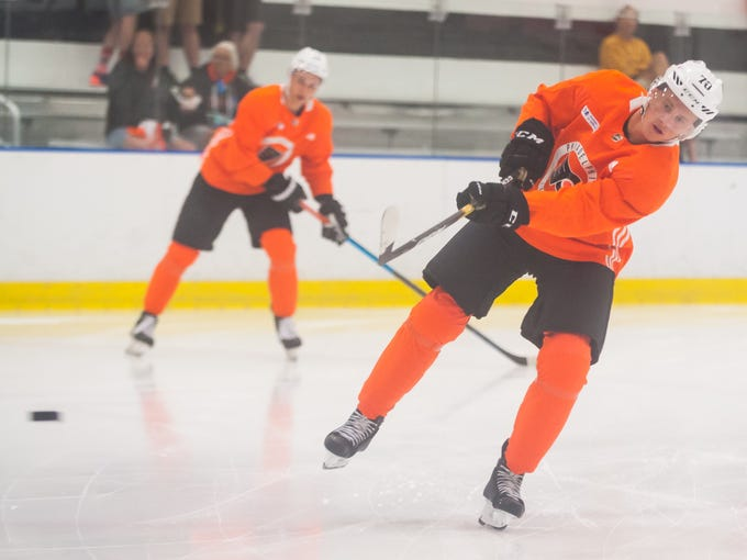 Flyers center Olle Lycksell (70) takes a shot in warm