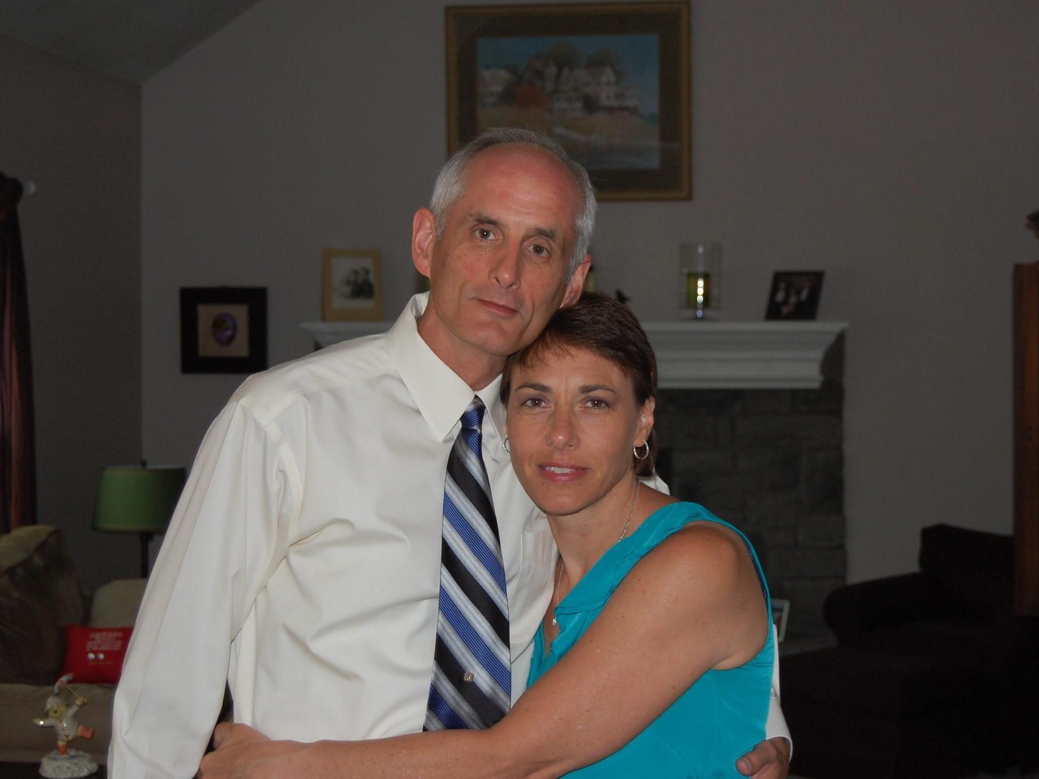 Elder swim coach John Book joins his wife, Kari.