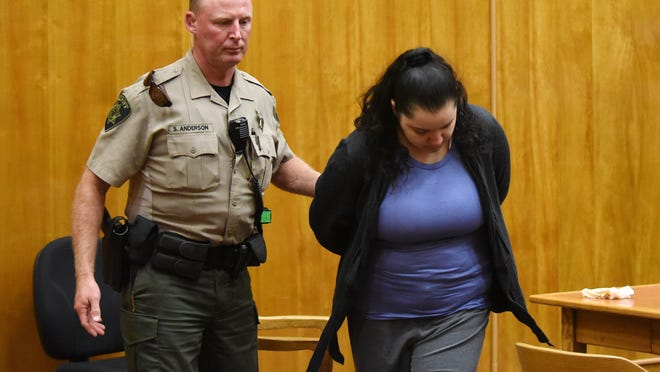 Marion County Sheriff's Office Deputy Shan Anderson takes Mercedes Alvarado into custody after she was found guilty of first-degree manslaughter for the death of her 3-year-old daughter, Aniya Zamora, during a trial on Friday, June 19, 2015, at the Marion County Courthouse in downtown Salem.