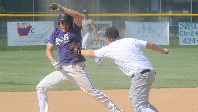 Lockeroom third baseman Kyle Stephens, right, tags teammate Hayden Hall during practice on Tuesday. Hall and Stephens are two 19-year-olds who are among 10 returning players to The Lockeroom this season.