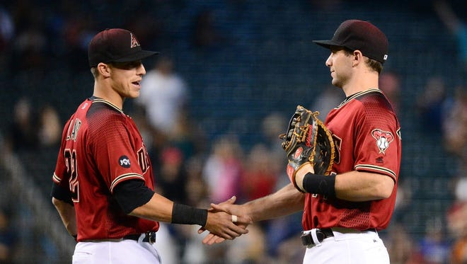 May 29, 2016: Arizona Diamondbacks infielders Jake Lamb (22) and Paul Goldschmidt (44) shake hands after closing out the game against the San Diego Padres at Chase Field. The Arizona Diamondbacks won 6-3.