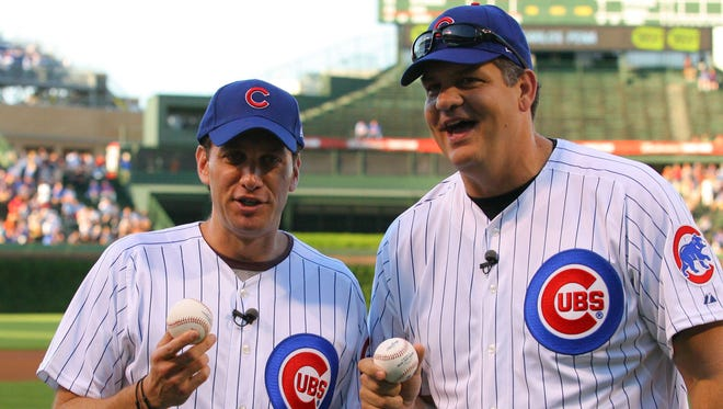 ESPN personalities Mike Greenberg  (left) and Mike Golic (right) prior to a game between the Chicago Cubs and the San Francisco Giants at Wrigley Field in 2011.